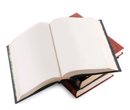 Open book with blank pages on a pile of books Stock Images