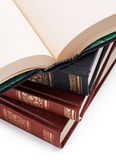 Open book with blank pages on a pile of books Royalty Free Stock Images