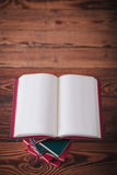 Open book with blank pages on top of other books Stock Image