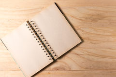 Open book with blank pages on wooden background Royalty Free Stock Image