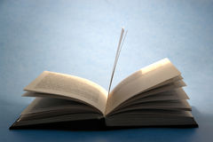 Open book on blue Stock Image