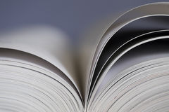 Open book on blue background Stock Photos