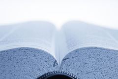 Open book in blue. Open textbook in blue with blank top half for type Royalty Free Stock Photo
