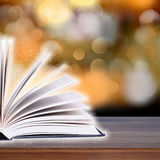 Open book with bokeh light on wood planks Stock Photos