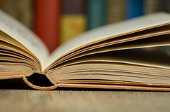 Open book with books in background. Image of open book with books in background Royalty Free Stock Image