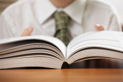 Open book in boy hands Stock Photos