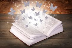 Open book with butterflies  Royalty Free Stock Photos