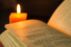 Open book and candle Royalty Free Stock Photography