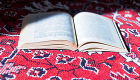 Open book on carpet Royalty Free Stock Images