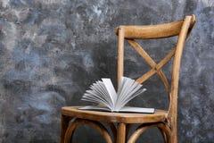 Open book on chair stock photos