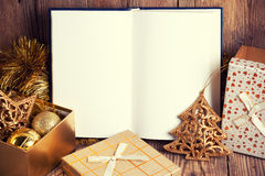 Open book with christmas decoration. On wooden background Stock Photography