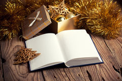 Open book. With christmas decoration on wooden background Royalty Free Stock Photography