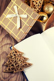 Open book with christmas decoration. On wooden background Royalty Free Stock Photo