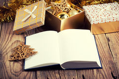Open book with christmas decoration Royalty Free Stock Images