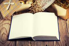 Open book. With christmas decoration on wooden background Stock Photo