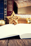 Open book. With christmas decoration on wooden background Royalty Free Stock Images