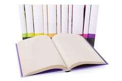 Open book and a collection of books. Isolated on white background Stock Photography