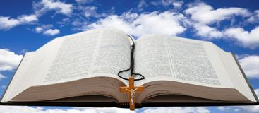 Open book and a cross Royalty Free Stock Images