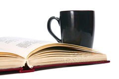 Open book and cup Royalty Free Stock Photo