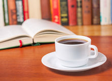 Open book and a cup of coffee Royalty Free Stock Image