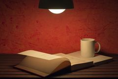 An open book. A cup of coffee on the table and an open book Royalty Free Stock Photo
