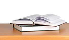 Open book on desk Royalty Free Stock Photos