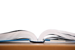 An open book on a desk. In a class room Stock Photos