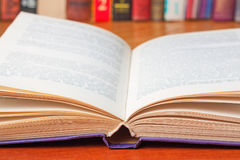 Open book on the desk close-up Royalty Free Stock Photography