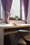 Open book on the desk. In girl's room Royalty Free Stock Photo