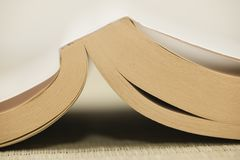 Open book with dog-ears bookmarks stock photos