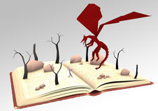 Open book of Dragons. Open book with paper knight fighting a dragon with burnt trees and rocks Royalty Free Stock Photography
