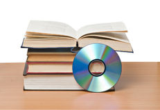 Open book  and DVD Royalty Free Stock Photo