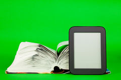 Open book and e-book reader Stock Photo