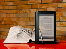Open book and electronic book reader Royalty Free Stock Photo