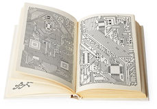 Open book with electronic schemes Stock Photo