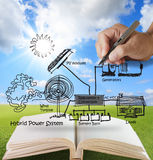 Open book of engineer. Draws hybrid power system,combine multiple sources diagram Stock Photo