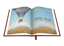 Open book of fairy tales on white background. Royalty Free Stock Photo