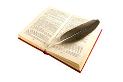 Open book with a feather Royalty Free Stock Photography