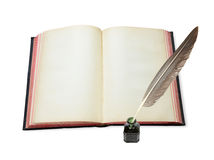 Open book  and feather in the inkwell Stock Image
