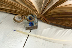 Open book and feather quill Stock Photo