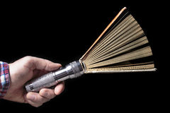 Open book and a flashlight in the hand of man Royalty Free Stock Image