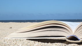 Open book with flipping pages stock video footage