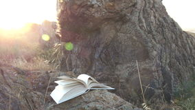 Open book with flipping pages at sunset stock footage