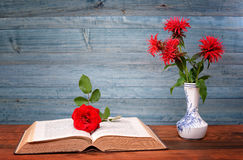 Open book, flower and rose ceramic vase Stock Image