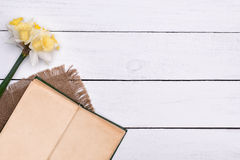 Open book with flower on wooden table background top view Stock Photography