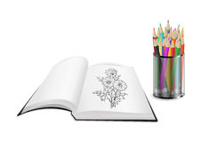 Open book with flowers and color pencils Royalty Free Stock Photo