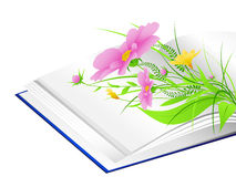 Open book with flowers and green grass Stock Photo