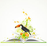 Open book with flowers and tropical bird Stock Photography