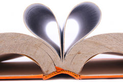 Open book forming the shape of love. On a white background Royalty Free Stock Photography