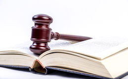 Open book with Gavel. An open book with gavel on a white back ground Royalty Free Stock Photo